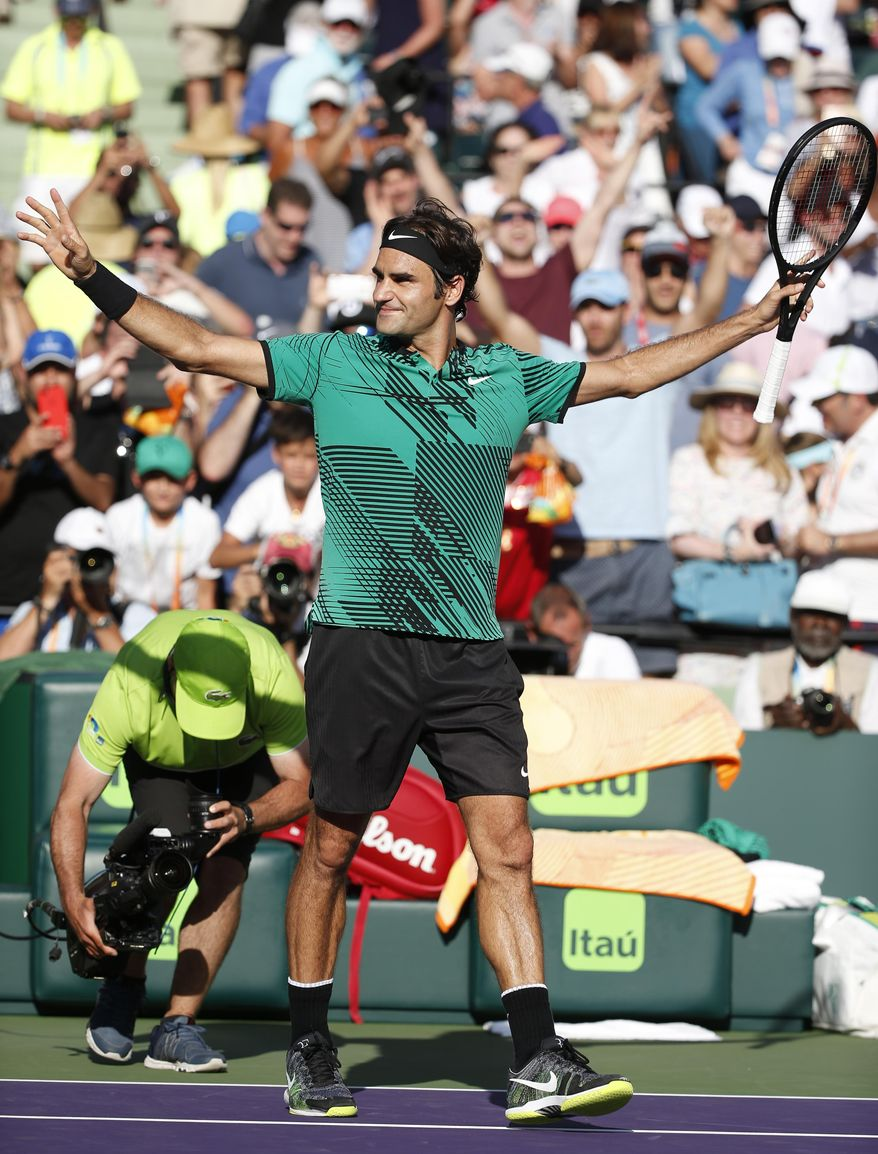Roger Federer, of Switzerland, celebrates after defeating Tomas Berdych, of the Czech Republic, 6-2, 3-6, 7-6 (6) at the Miami Open tennis tournament, Thursday, March 30, 2017, in Key Biscayne, Fla. (AP Photo/Wilfredo Lee)