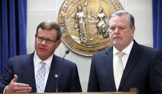 """FILE - In this Tuesday, March 28, 2017 file photo, Republican leaders Rep. Tim Moore, left, and Sen. Phil Berger, hold a news conference in Raleigh, N.C. North Carolina Republican lawmakers said Wednesday night that they have an agreement with Democratic Gov. Roy Cooper on legislation to resolve a standoff over the state's """"bathroom bill."""" Details about the replacement weren't immediately available, Moore and Berger declined to take questions during a brief news conference. (Chris Seward/The News & Observer via AP, File)"""