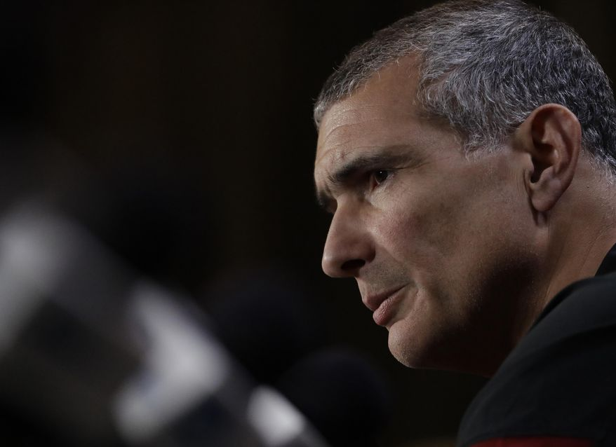 South Carolina head coach Frank Martin answers questions after a practice session for their NCAA Final Four tournament college basketball semifinal game Thursday, March 30, 2017, in Glendale, Ariz. (AP Photo/David J. Phillip)
