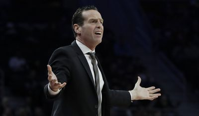 Brooklyn Nets head coach Kenny Atkinson gestures from the bench during the first half of the team's NBA basketball game against the Detroit Pistons, Thursday, March 30, 2017, in Auburn Hills, Mich. (AP Photo/Carlos Osorio)