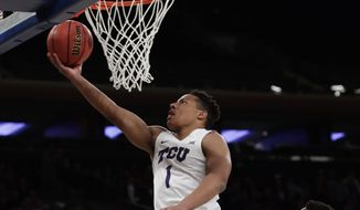 TCU's Desmond Bane (1) drives to the basket past Georgia Tech's Quinton Stephens, right, during the first half of an NCAA college basketball game in the final of the NIT Thursday, March 30, 2017, in New York. (AP Photo/Frank Franklin II)