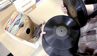 Boxed record sets are among a donation of more than 21,000 vinyl record albums at Agrace Thrift Shop in Madison, Wis. Wednesday, March 29, 2017. Most of the records will sell for $1 to $4, but others that are more collectible could fetch $10 to $60, depending on artist, title and condition. Roh spent years building the record collection. He says he tired of the hobby about three years ago, and decided last month to put it to a good cause. ( John Hart/Wisconsin State Journal via AP)