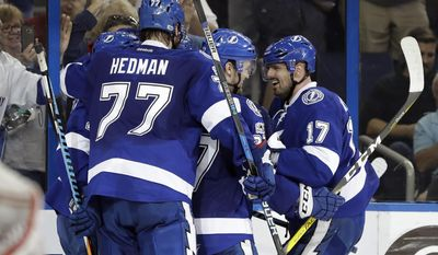 Tampa Bay Lightning left wing Alex Killorn (17) celebrates with teammates, including defenseman Victor Hedman (77), after scoring against the Detroit Red Wings during the second period of an NHL hockey game Thursday, March 30, 2017, in Tampa, Fla. (AP Photo/Chris O'Meara)