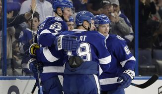Tampa Bay Lightning defenseman Andrej Sustr (62) celebrates with teammates, including left wing Ondrej Palat (18), after scoring against the Detroit Red Wings during the second period of an NHL hockey game Thursday, March 30, 2017, in Tampa, Fla. (AP Photo/Chris O'Meara)