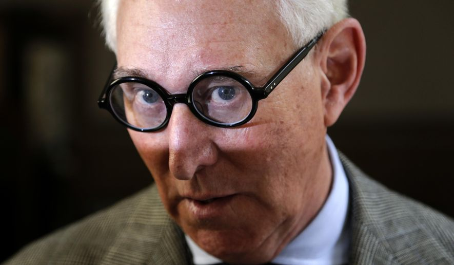 "Roger Stone talks to reporters outside a courtroom in New York, Thursday, March 30, 2017. Stone, a longtime political provocateur and adviser to President Donald Trump, is being sued over a flyer sent to 150,000 New York households during the state's 2010 election that called the Libertarian Party candidate for governor, Warren Redlich, a ""sexual predator."" Stone says he had nothing to do with it. (AP Photo/Seth Wenig)"