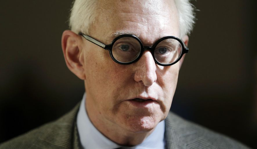Roger Stone talks to reporters outside a courtroom in New York, Thursday, March 30, 2017. (AP Photo/Seth Wenig)