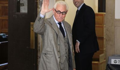 "Roger Stone waves to photographers in the courthouse in New York, Thursday, March 30, 2017. Stone, a longtime political provocateur and adviser to President Donald Trump, is being sued over a flyer sent to 150,000 New York households during the state's 2010 election that called the Libertarian Party candidate for governor, Warren Redlich, a ""sexual predator."" Stone says he had nothing to do with it. (AP Photo/Seth Wenig)"