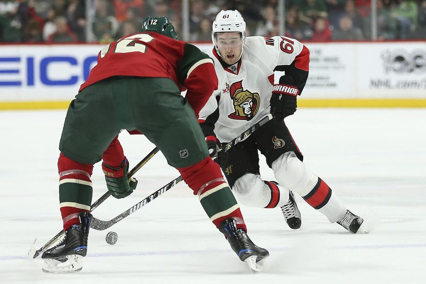 Ottawa Senators' Mark Stone (61) controls the puck against Minnesota Wild's Eric Staal (12) in the second period of an NHL hockey game Thursday, March 30, 2017, in St. Paul, Minn. (AP Photo/Stacy Bengs)