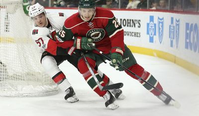 Minnesota Wild's Jonas Brodin (25) controls the puck around the back of the net against Ottawa Senators' Tommy Wingels (57) in the second period of an NHL hockey game Thursday, March 30, 2017, in St. Paul, Minn. (AP Photo/Stacy Bengs)