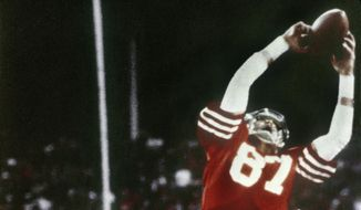 FILE - In this Jan. 10, 1982, file photo, Dallas Cowboys' Everson Walls, obscured at rear, defends as San Francisco 49ers' Dwight Clark leaps high in the end zone to catch a Joe Montana pass for a touchdown in the fourth quarter of the NFC Championship NFL football game at Candlestick Park in San Francisco. Walls doesn't want to talk about The Catch, and not just because he wasn't the one catching the ball.   (Phil Huber/The Dallas Morning News via AP, File) **FILE**
