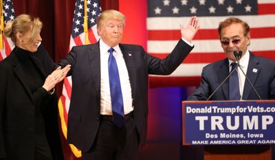 FILE - In this Jan. 28, 2016, file photo, then-Republican presidential candidate Donald Trump listens as Treasure Island Casino owner Phil Ruffin, right, speaks at a event in support of veterans at Drake University in Des Moines, Iowa. At left is Ruffin's wife, Oleksandra Nikolayenko. Ruffin has never been to the White House, but on March 30, 2017, he'll have dinner there with his friend, President Donald Trump.(AP Photo/Andrew Harnik, File)