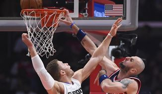 Washington Wizards center Marcin Gortat, right, of Poland, attempts to dunk as Los Angeles Clippers forward Blake Griffin defends during the first half of an NBA basketball game, Wednesday, March 29, 2017, in Los Angeles. (AP Photo/Mark J. Terrill)