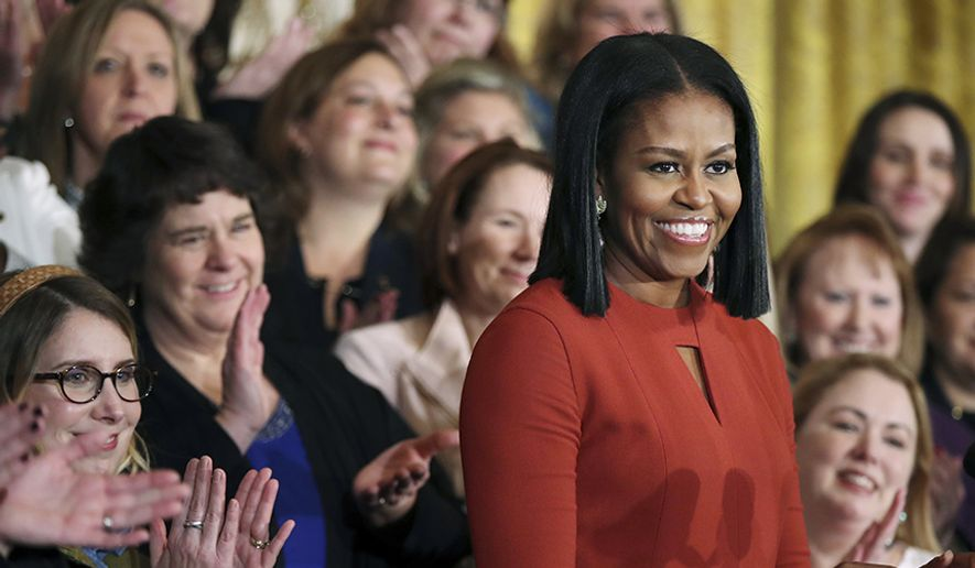 Michelle Obama, 53, former first lady of the United States, cemented her legacy as a fashion icon, a role model for women, and an advocate for poverty awareness, nutrition, physical activity, and healthy eating. (AP Photo) ** FILE **