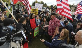 In this Sept. 28, 2016, file photo, dozens of anti-Trump protesters, left, and Trump supporters argue as they gather outside the Bolingbrook Country Club, where then-presidential candidate Donald Trump was attending a fundraiser In Bolingbrook, Ill. (Antonio Perez/Chicago Tribune via AP)