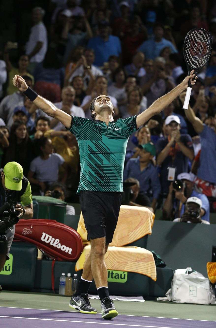 Roger Federer, of Switzerland, celebrates after defeating Nick Kyrgios, of Australia, 7-6 (9), 6-7 (9), 7-6 (5) in a tennis match at the Miami Open, Friday, March 31, 2017 in Key Biscayne, Fla. (AP Photo/Wilfredo Lee)