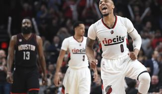 Portland Trail Blazers guard Damian Lillard celebrates as the Blazers take the lead late during the fourth quarter of an NBA basketball game against the Houston Rockets in Portland, Ore., Thursday, March 30, 2017. The Blazers won 117-107. (AP Photo/Steve Dykes)
