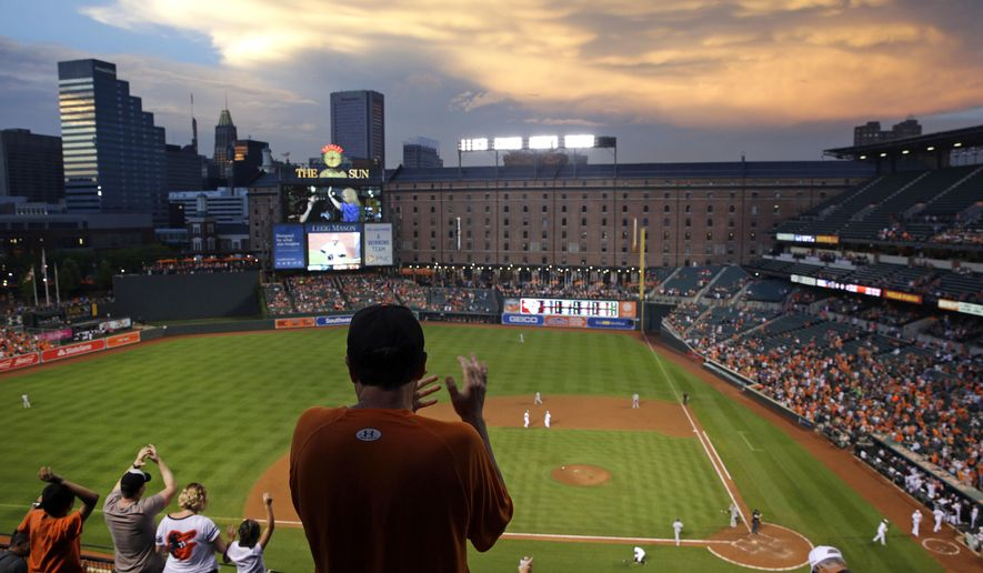 The sun sets over Oriole Park at Camden Yards as fans cheer after Baltimore Orioles' Francisco Pena scored on an Adam Jones double in the third inning of an interleague baseball game against the San Diego Padres in Baltimore, Tuesday, June 21, 2016. It's been 25 years since the Baltimore Orioles began playing in Camden Yards, the start of a nationwide trend of major league teams moving into new ballparks. (AP Photo/Patrick Semansky)