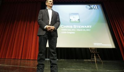 Republican U.S. Rep. Chris Stewart conducts his town hall meeting Friday, March 31, 2017, in Salt Lake City. Stewart says he knows that many of those attending his town hall in heavily Democratic Salt Lake City probably didn't vote for him, but the Republican congressman says he feels it's important to appear before his constituents. (AP Photo/Rick Bowmer)