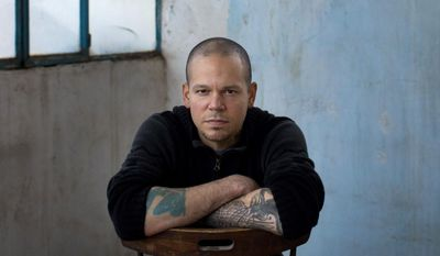 FILE - In this Dec. 5, 2013 file photo, Rene Perez Joglar, also known as Residente, of the musical group Calle 13, poses for a portrait in the West Bank town of Beit Shaour, near Bethlehem. Residente's self-titled album will be released on Friday, March 31, 2017.  (AP Photo/Bernat Armangue, File)