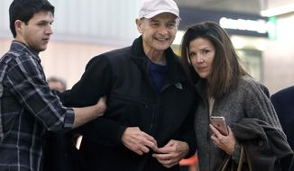 FILE - In this Nov. 22, 2016 file photo, former Massachusetts House Speaker Salvatore DiMasi, center, is flanked by stepson Christian, left, and wife Debbie, right, as he arrives at Logan International Airport in Boston. Federal Judge Mark Wolf, who granted DiMasi an early release from prison, on Friday, March 31, 2017, denied a request to ease his home confinement, but agreed to allow him to participate in a rehabilitation program at the YMCA and leave home for up to two hours of exercise a day. DiMasi was granted compassionate release after serving five of eight years in prison on corruption charges. He was treated for tongue and prostate cancer while in prison. (AP Photo/Steven Senne, File)
