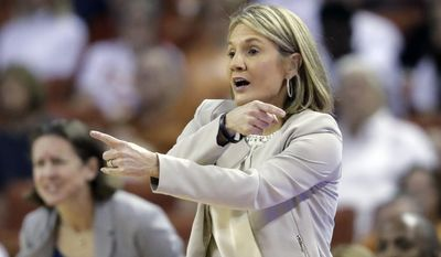 FILE - In this March 19, 2017, file photo, Texas coach Karen Aston directs her players during a second-round game against North Carolina State in the NCAA women's college basketball tournament in Austin, Texas. Texas played all four teams in the Final Four this season, and Aston takes a look at the semifinals. (AP Photo/Eric Gay, File)