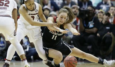 South Carolina guard Allisha Gray (10) and Stanford forward Alanna Smith (11) scramble for the ball during the first half of an NCAA college basketball game in the semifinals of the women's Final Four, Friday, March 31, 2017, in Dallas.(AP Photo/Tony Gutierrez)