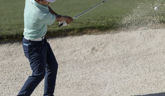 Sung Kang hitting out of a sand trap on the 18th green during the second round of the Shell Houston Open golf tournament Friday, March 31, 2017, at The Golf Club of Houston in Humble, Texas. (Wilf Thorne/Houston Chronicle via AP)