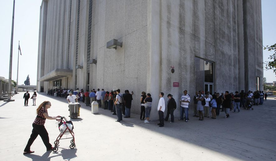 In this March 18, 2010, photo, people line up outside the Metropolitan Courthouse in Los Angeles. Attorney General Jeff Sessions and Homeland Security Secretary John Kelly are defending federal agents who make immigration arrests at courthouses after California's top judge asked them to stop. The officials sent a letter this week to Chief Justice Cantil-Sakauye saying state and local policies that bar police from turning over suspects for deportation have compelled federal agents to make arrests at courthouses and other public places. (AP Photo/Damian Dovarganes) **FILE**