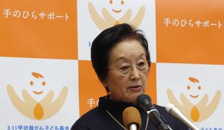 Hisako Sakiyama, a medical doctor and representative of the 3.11 Fund for Children With Thyroid Cancer, speaks to reporters in Tokyo, Friday, March 31, 2017.  Sakiyama, who has sat on government panels to investigate the Fukushima disaster, says a child who was 4 at the time of the disaster , has been diagnosed with thyroid cancer and that case is missing from the official government records.   (AP Photo/Yuri Kageyama)
