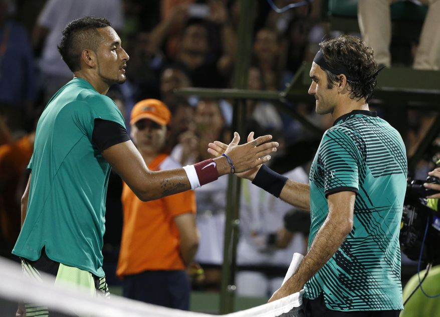 Roger Federer, of Switzerland, right, and Nick Kyrgios, of Australia, congratulate each other after Federer defeated Kyrgios 7-6 (9), 6-7 (9), 7-6 (5) during a tennis match at the Miami Open, Friday, March 31, 2017 in Key Biscayne, Fla. (AP Photo/Wilfredo Lee)