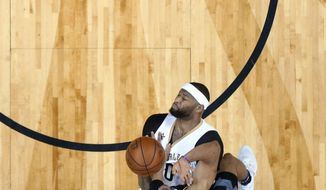 Sacramento Kings forward Skal Labissiere (3) is fouled by New Orleans Pelicans forward DeMarcus Cousins (0) as he drives to the basket in the first half of an NBA basketball game in New Orleans, Friday, March 31, 2017. (AP Photo/Gerald Herbert)