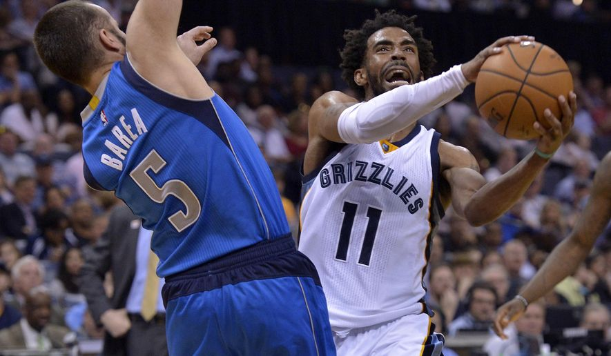 Memphis Grizzlies guard Mike Conley (11) drives against Dallas Mavericks guard J.J. Barea (5) in the second half of an NBA basketball game Friday, March 31, 2017, in Memphis, Tenn. (AP Photo/Brandon Dill)