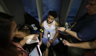 North Carolina's Joel Berry II answers questions after a practice session for their NCAA Final Four tournament college basketball semifinal game Thursday, March 30, 2017, in Glendale, Ariz. (AP Photo/David J. Phillip)