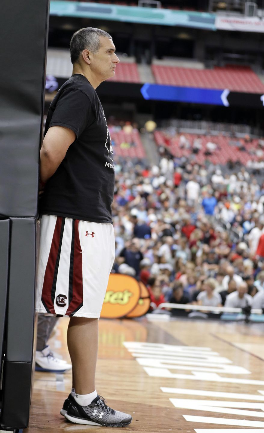 South Carolina head coach Frank Martin watches during a practice session for their NCAA Final Four tournament college basketball semifinal game Friday, March 31, 2017, in Glendale, Ariz. (AP Photo/Mark Humphrey)