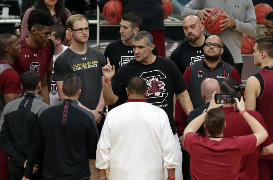 South Carolina head coach Frank Martin talks to his team during a practice session for their NCAA Final Four tournament college basketball semifinal game Friday, March 31, 2017, in Glendale, Ariz. (AP Photo/Matt York)