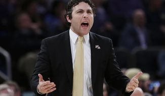 Georgia Tech's head coach Josh Pastner shouts to his team against TCU during the first half of an NCAA college basketball game in the final of the NIT Thursday, March 30, 2017, in New York. (AP Photo/Frank Franklin II)