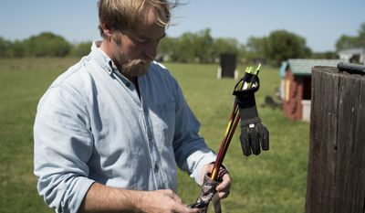 "Eric Wilson returns arrows to their quiver after practicing archery, Wednesday, March 29, 2017, at his home in Jourdanton, Texas. Wilson is one of four men known as the ""Norfolk Four,"" who have long claimed police bullied them into falsely confessing to the 1997 rape and murder of Michelle Moore-Bosko in Norfolk, Virginia. Wilson was recently pardoned by Virginia Gov. Terry McAuliffe, ending a decades-long fight to clear his name. A pardon was the only recourse for Wilson, whose attempts to get his rape conviction thrown out in court had failed because of a technicality. (AP Photo/Darren Abate)"