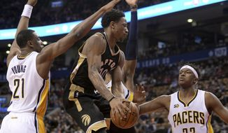 Toronto Raptors guard DeMar DeRozan (10) drives to the net as Indiana Pacers forward Thaddeus Young (21) and Indiana Pacers center Myles Turner (33) defend during the first half of an NBA basketball game, Friday, March 31, 2017, in Toronto. (Nathan Denette/The Canadian Press via AP)