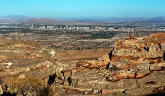 FILE - This Oct. 11, 2016 file photo shows a view of Las Vegas from the top of the Blue Diamond Hill Gypsum Mine, where developer Jim Rhodes seeks to build a master planned community with 5,000-plus units. After more than a decade of community and legal battles, county commissioners are again considering Rhodes' plan to build on property within eyesight of a national recreation area. (L.E. Baskow/Las Vegas Sun via AP, File)