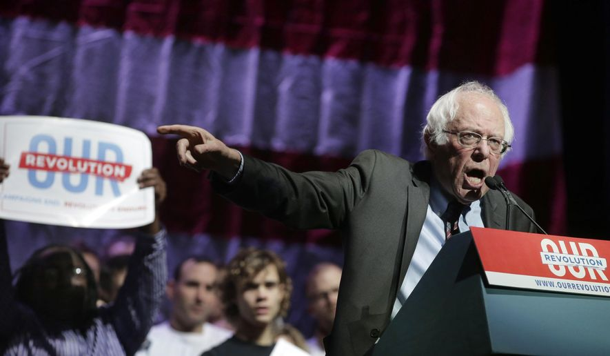 Sen. Bernie Sanders, I-Vt., addresses an audience during a rally Friday, March 31, 2017, in Boston. (AP Photo/Steven Senne)