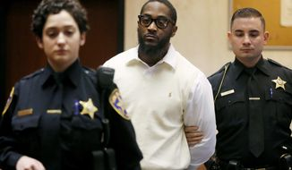 Essex County Sheriff's officers lead Basim Henry, one of four men charged with the December 2013 fatal shooting and carjacking of Dustin Friedland at an upscale New Jersey mall, into court where a jury found him guilty on all counts for his role in Friedland's murder, Friday, March 31, 2017, in Newark, N.J. (Robert Sciarrino /NJ Advance Media via AP, Pool)