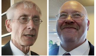 FILE - The combination of March 15, 2017 file photos, shows incumbent Wisconsin state Superintendent Tony Evers, left, and his challenger Lowell Holtz. The two men will meet for a debate Friday, March 31, 2017, in Madison ahead of the April 4, 2017 general election. Evers is seeking a third term. Holtz is a former superintendent in Whitnall and Beloit. (AP Photo/Scott Bauer, File)