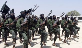 Hundreds of newly trained al-Shabab fighters perform military exercises in the Lafofe area some 18 km south of Mogadishu, in Somalia, in this Feb. 17, 2011, file photo. (AP Photo/Farah Abdi Warsameh, File)