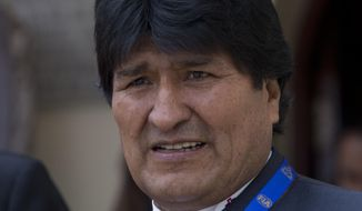 Bolivia's President Evo Morales attend ceremony to announce the route of the 2018 Dakar Rally, in La Paz, Bolivia, March 29, 2017. The 2018 Dakar Rally will pass through Peru, Bolivia and Argentina. (AP Photo/Juan Karita)