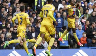 Crystal Palace's Wilfried Zaha, right celebrates after scoring his side's first goal during the English Premier League soccer match between Chelsea and Crystal Palace at Stamford Bridge stadium in London Saturday, April 1, 2017. (AP Photo/Alastair Grant)