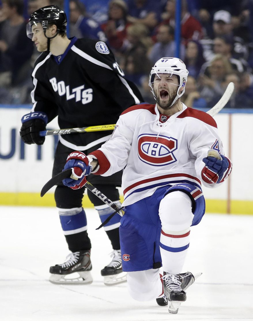 Montreal Canadiens right wing Alexander Radulov (47) celebrates in front of Tampa Bay Lightning left wing Jonathan Drouin (27) after scoring during overtime of an NHL hockey game Saturday, April 1, 2017, in Tampa, Fla.  (AP Photo/Chris O'Meara)