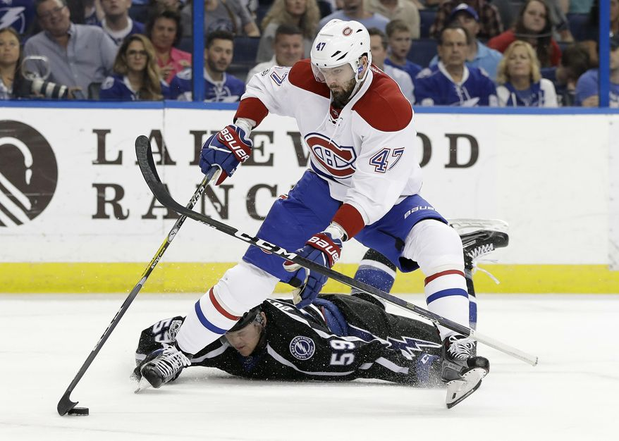 Montreal Canadiens right wing Alexander Radulov (47) gets by as Tampa Bay Lightning defenseman Jake Dotchin (59) loses his stick during the first period of an NHL hockey game Saturday, April 1, 2017, in Tampa, Fla. (AP Photo/Chris O'Meara)