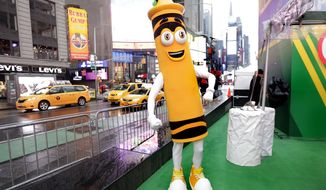 "A dandelion crayon character poses for photos during a Crayola event in New York's Times Square, Friday, March 31, 2017. Crayola announced Friday, National Crayon Day, that it's replacing the color dandelion in its 24-pack with a crayon in ""the blue family."" (AP Photo/Richard Drew)"