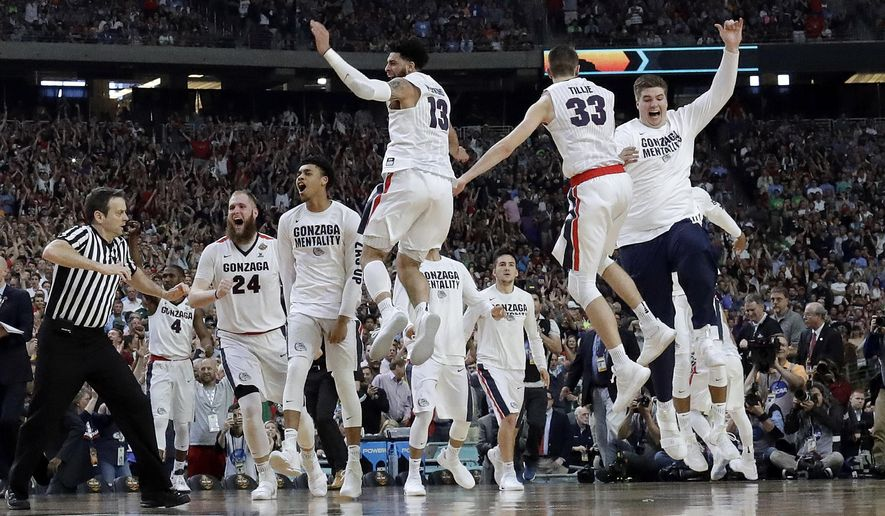 Gonzaga players celebrate after the semifinals of the Final Four NCAA college basketball tournament against South Carolina, Saturday, April 1, 2017, in Glendale, Ariz. Gonzaga won 77-73. (AP Photo/David J. Phillip)