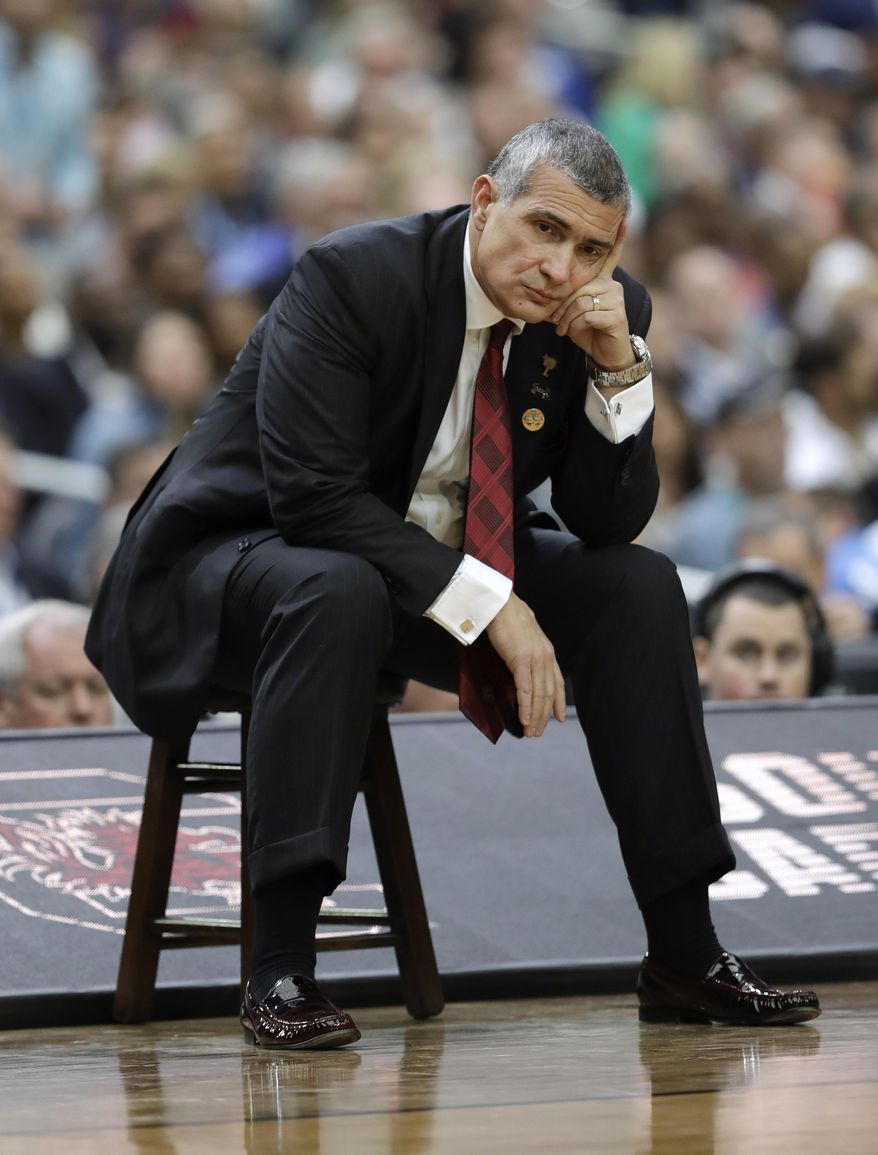 South Carolina head coach Frank Martin watches from the bench during the first half against Gonzaga in the semifinals of the Final Four NCAA college basketball tournament, Saturday, April 1, 2017, in Glendale, Ariz. (AP Photo/David J. Phillip)